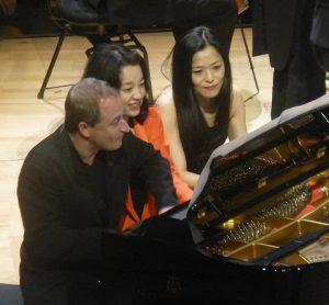 Itamar Golan, Akane Sakai, Natsuko Inoue sharing the piano